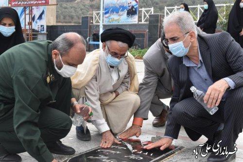 عطر افشانی گلزار شهدای شهرستان علی آبادکتول